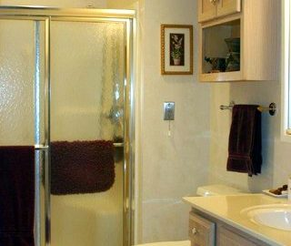 We have bathrooms with both walk in showers or tub / shower combinations.